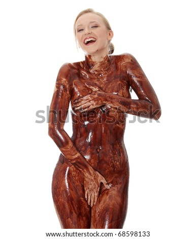 Young beautiful woman with her naked body covered of sweet cream chocolate, isolated on white - stock photo