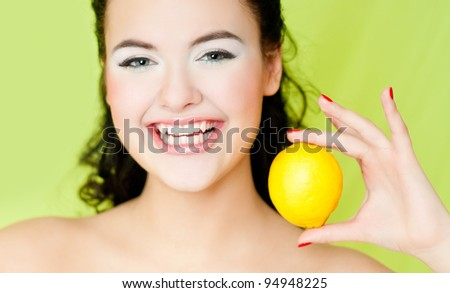 young beautiful woman with lemon - stock photo
