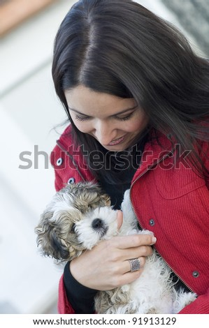 Young beautiful woman with little dog - stock photo
