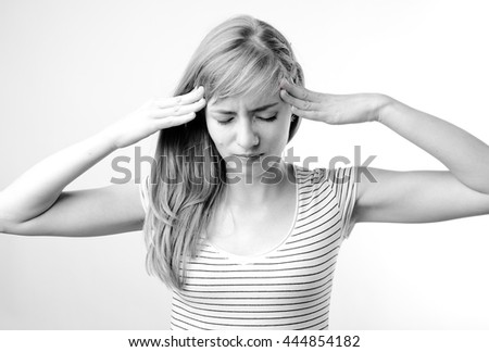 Young beautiful woman with long light hair in bad mood, crying, feels bad and in depression - stock photo