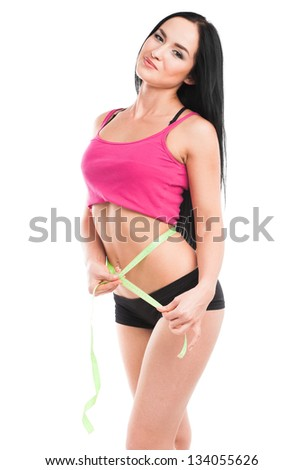 Young beautiful woman with measure tape, isolated on white