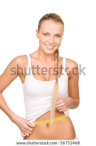 young beautiful woman with measure tape over white - stock photo