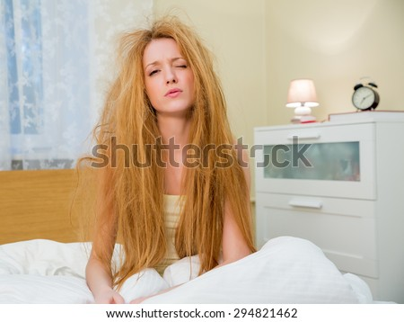 Young beautiful woman with messy hair - stock photo