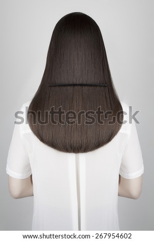 young beautiful woman with paint on the back.Beauty hairstyle. Body art sexy girl - stock photo