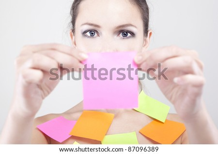 young beautiful woman with paper for notes on her body