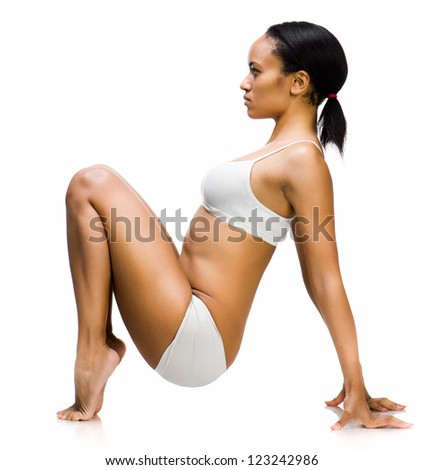 young beautiful woman with perfect body.  Isolated on a white background