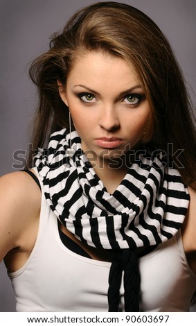 Young beautiful woman with perfect natural makeup on gray background - stock photo