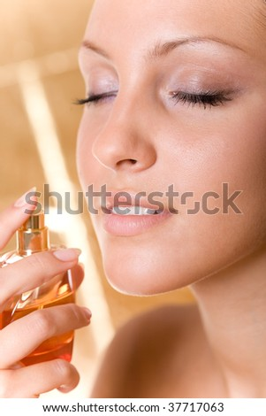young beautiful woman with perfume - stock photo