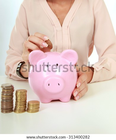 Young beautiful woman  with piggy bank, isolated on white background