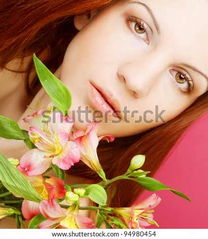 young beautiful woman with pink flowers over pink background - stock photo