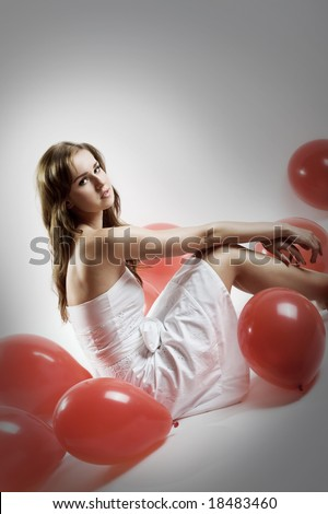 young beautiful woman with red balloons