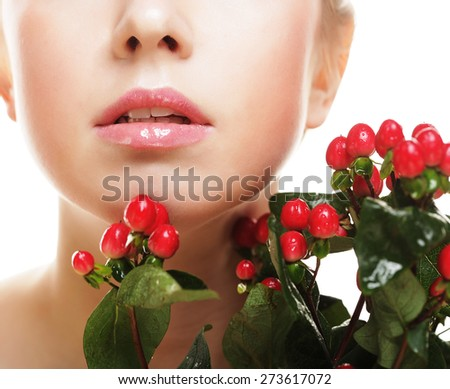 young beautiful woman with red flowers  isolated on white. - stock photo