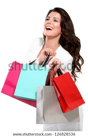 Young beautiful woman with shopping bag on white - stock photo