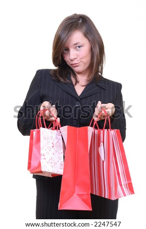 young beautiful woman with shopping bags isolated on white - stock photo