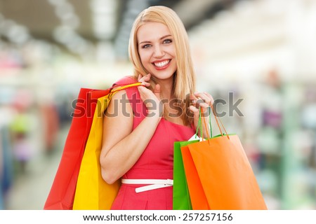 Young beautiful woman with shopping bags, white background - stock photo
