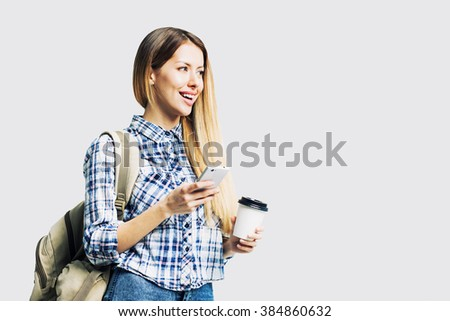 Young beautiful woman with smart phone - stock photo