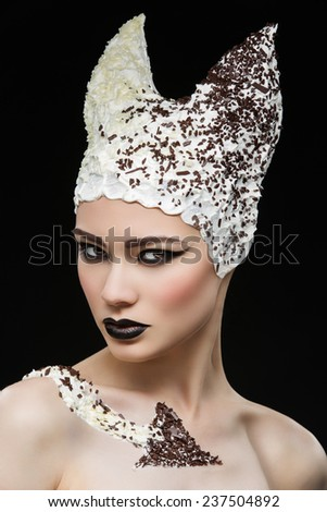Young beautiful woman with stylish gothic makeup and cream hairdo - stock photo