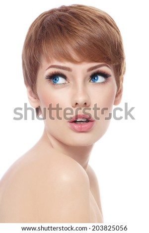 Young beautiful woman with stylish short haircut and fresh make-up looking upwards with interest over white background - stock photo