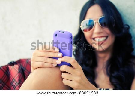 Young beautiful woman writing on phone - stock photo