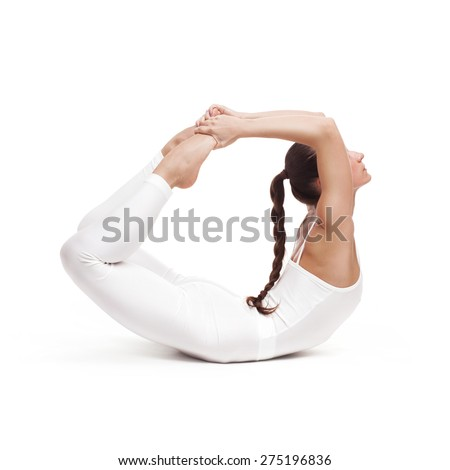 young beautiful woman yoga posing on isolated white studio background - stock photo