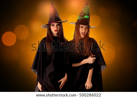 young beautiful women in halloween style posing in studio
