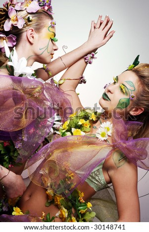Young beautiful women in pink and white flowers. - stock photo