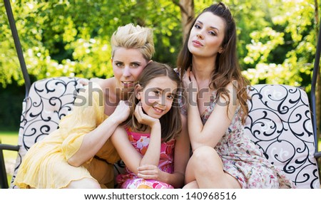 Young beautiful women in the garden - stock photo