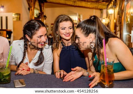 Young beautiful women with cocktails in bar or club