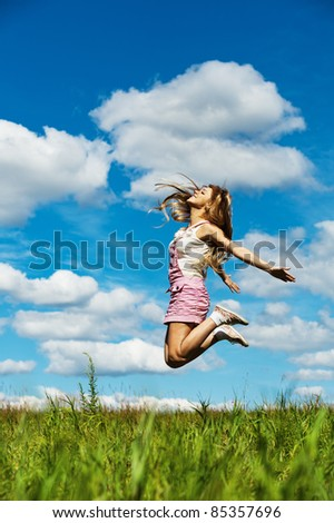 young beautiful young woman long hair high jumps
