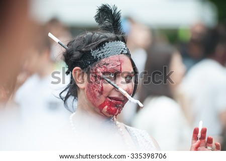 Young beautiful zombie woman scares at Sydney Zombie Walk in Sydney, AU, 31st October, 2015. Annual event where thousands of people get involved to raise awareness for Australia's Brain Foundation. - stock photo