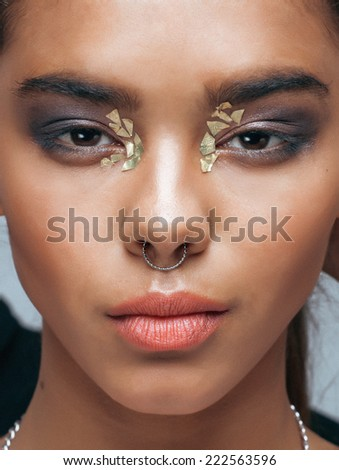young beauty african american woman with fashion make up, emothional face closeup - stock photo