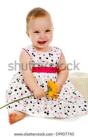 Young beauty baby with yellow flower - stock photo