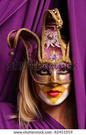 young beauty blonde woman in violet mask - stock photo