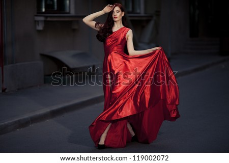 Young Beauty Famous Woman In Red Dress Outdoor - stock photo