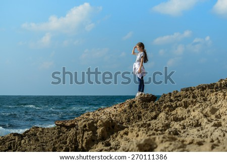 Young Beauty Girl By Sea Coast Under Sunlight