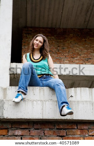 young beauty girl in the old rusty building