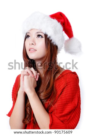 Young Beauty Girl wish with christmas hat and red cloth - stock photo