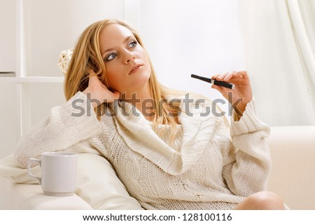 young beauty girl with e-cigarette - stock photo