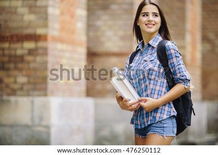 Young beauty girl with handbag goind to study to University