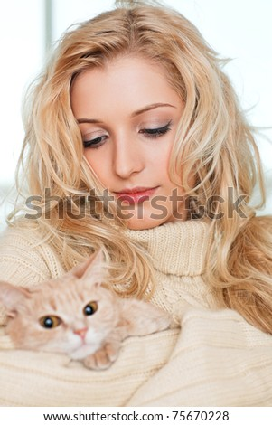 young beauty girl with the red cat - stock photo