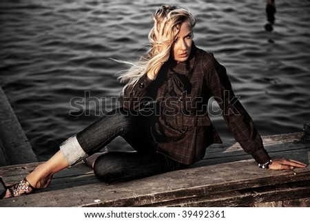Young beauty on a seashore - stock photo