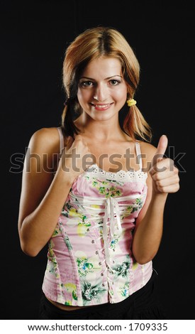 Young beauty showing thumb up sign - black background - very high resolution - stock photo