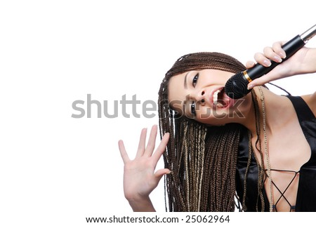 Young beauty singer girl holding microphone and singing