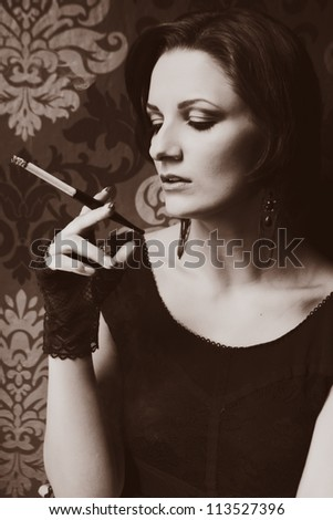 Young beauty smoking tobacco