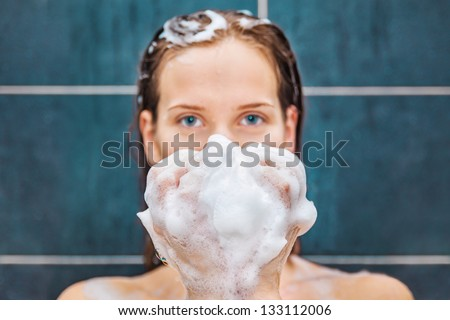 Young beauty under shower - stock photo