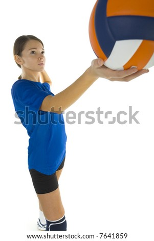 Young, beauty volleyball player. Holding ball and looking at something. White background, side view - stock photo
