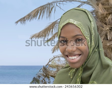 Young beauty wearing an embroidered veil - stock photo