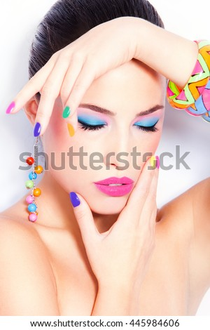 young beauty with colorful makeup and accessories