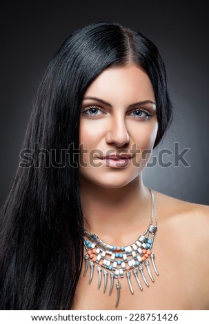 Young beauty with perfect skin and long dark hair - stock photo