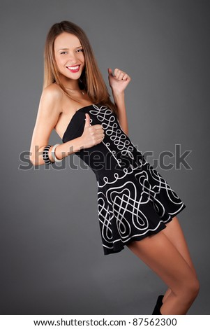 young beauty woman dansing pose in studio - stock photo